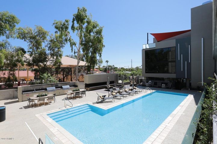 Community pool, BBQ grills, fireplace