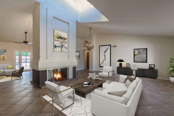 Fabulous space to entertain friends. A two sided fireplace to create perfect ambiance. High vaulted ceilings , skylights and lots of windows create a cheerful, bright living area.