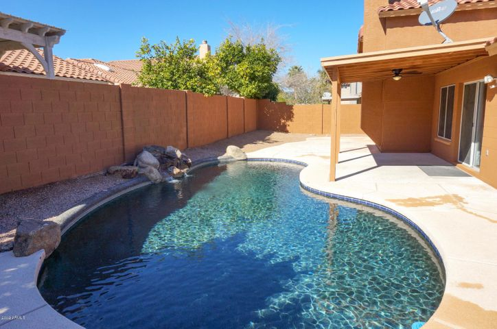 Beautiful Pebble Tech Pool With Water Feature