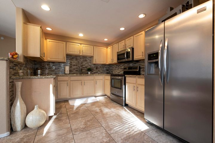 Remodeled Kitchen with granite counters and stainless steel appliances!