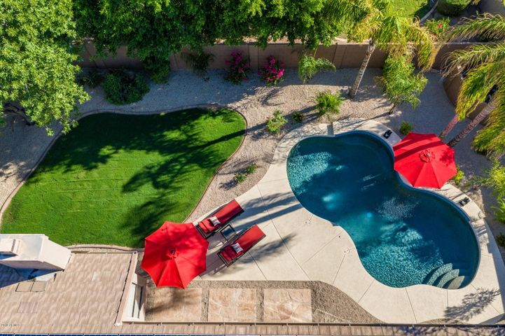AMAZING PRIVATE SANCTUARY! PEBBLE TECH POOL, PLENTY OF DECKING, NEW GRASS, FRUIT TREES, MATURE FICUS TREES CREATE PRIVACY FROM NEIGHBOR BEHIND, HUGE COVERED PATIO FOR ENTERTAINING!