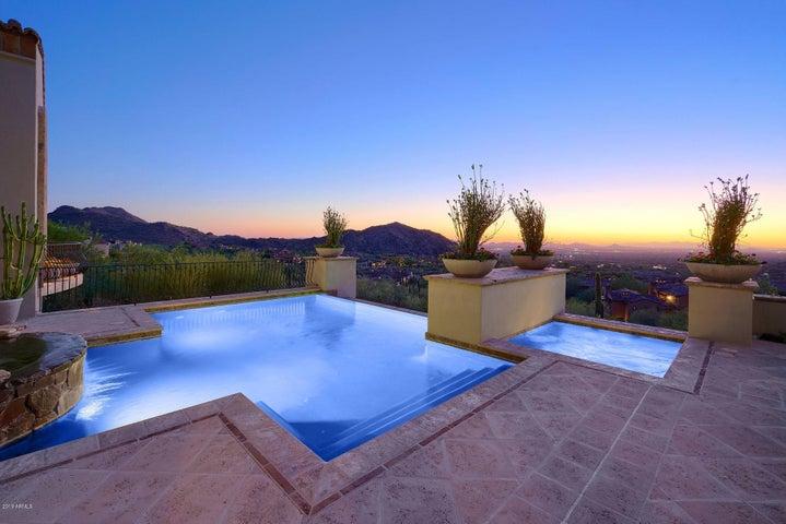 Pool With City Light Views