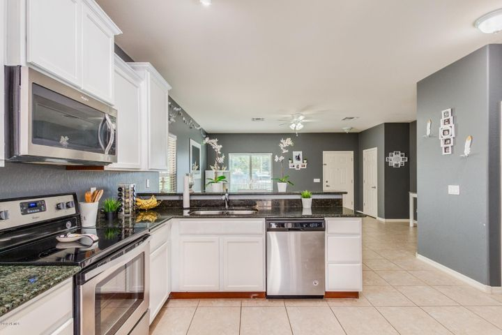42' white cabinets with granite counters.