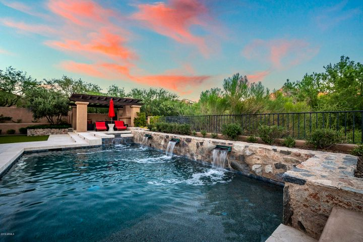 Entertainer's paradise with several different entertaining spaces, including a luxurious pool/spa, fireplace, fire/water features, private garden area and priceless mountain views.