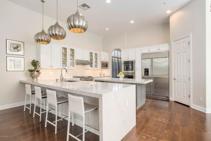 Updated kitchen features brand new countertops with waterfall edge.