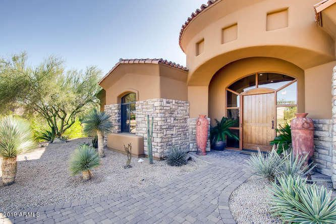 Large wood entry door welcomes you into this fantastic home