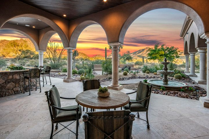This home offers numerous patios for enjoying panoramic views of the McDowell Mountains to the East.