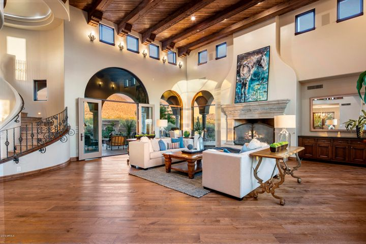 """This home has a """"grand"""" feel with a massive great room that flows into the dining room and kitchen."""