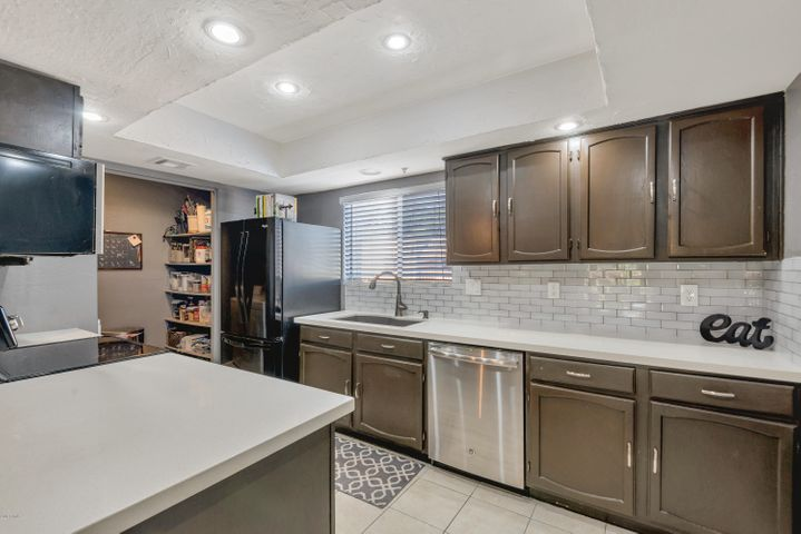 Remodeled Kitchen with granite and Subtile backsplash
