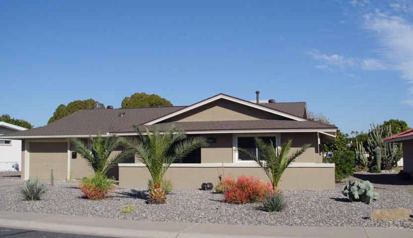 Exterior of the home has new stucco, paint and landscaping