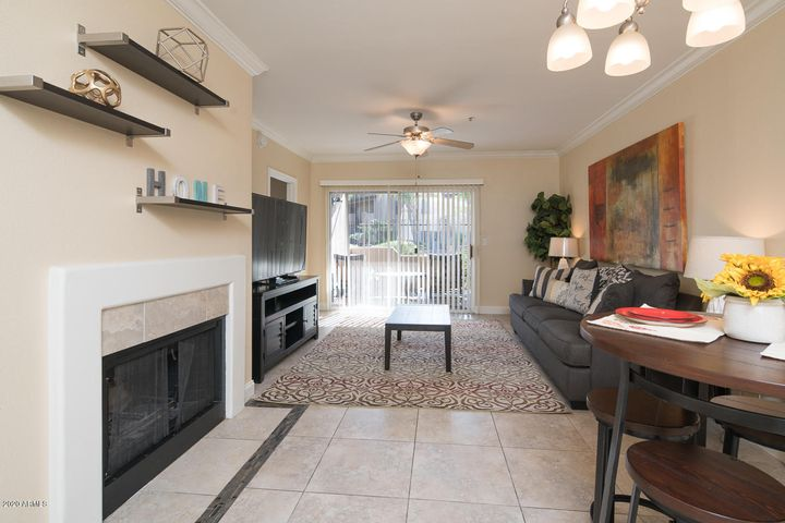 The tiled entry leads to the dining area with fireplace. The great room sliding door leads to poolside patio.