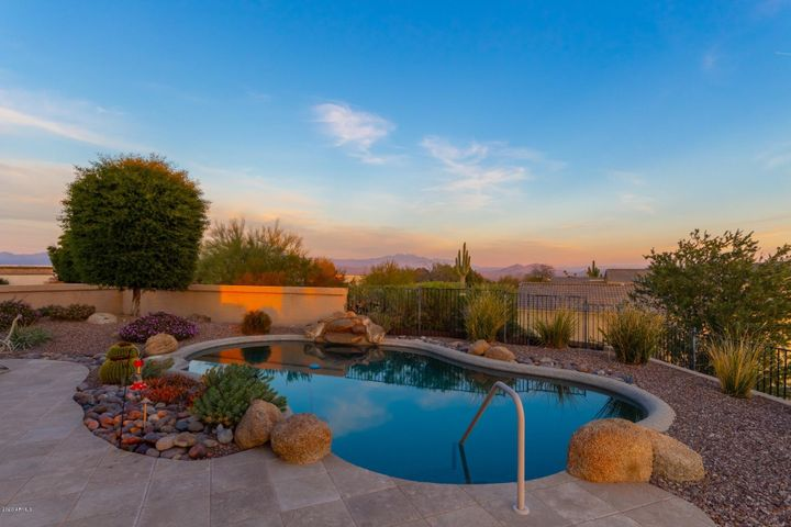 Pool with waterfall. Views of Red Rock and Four Peaks