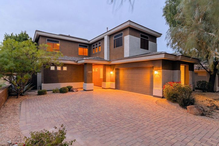 Stunning home with brick paver driveway and owned solar panels for low, low electricity bills.
