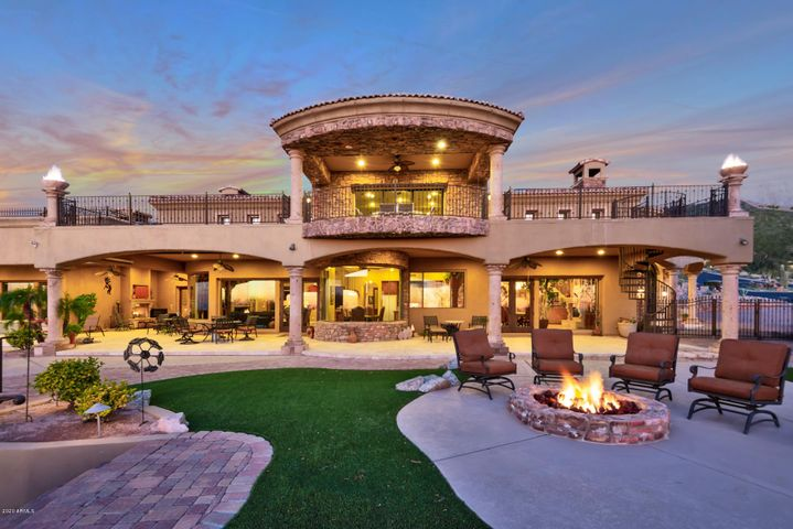 PATIO STRETCHING ENTIRE LENGTH OF HOME WITH FIRE BOWLS