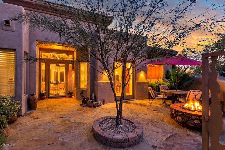 Expansive Gated Front Patio with Custom Fire Pit
