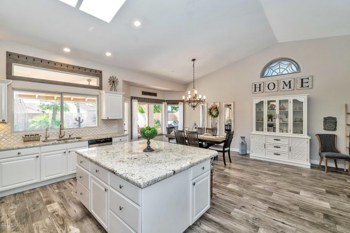 Beautiful floors, gorgeous granite, huge island w/ tons of storage plus seating space.