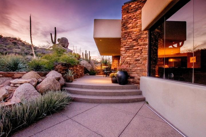 If this isn't the backyard views you're looking for, we don't know where else to look! Your guests will love the stunning boulder outcroppings bordering the property, especially at sunset time!