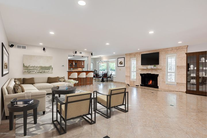 """20"""" neutral Porcelain tile! Surround sound, newer granite fireplace! Furniture virtually staged."""