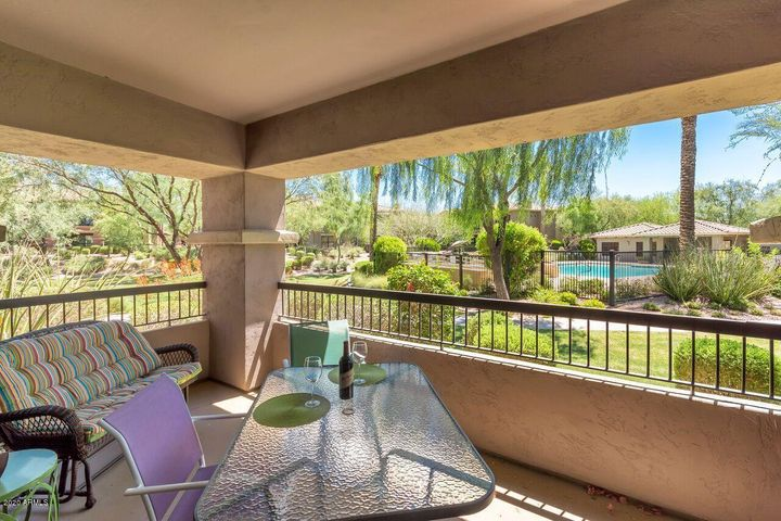 Patio has fabulous view of green grassy area and pool