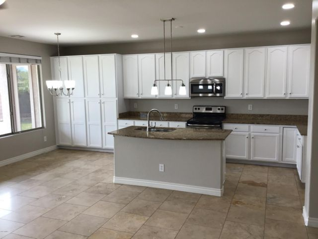Kitchen with granite counters and Stainless steel appliance