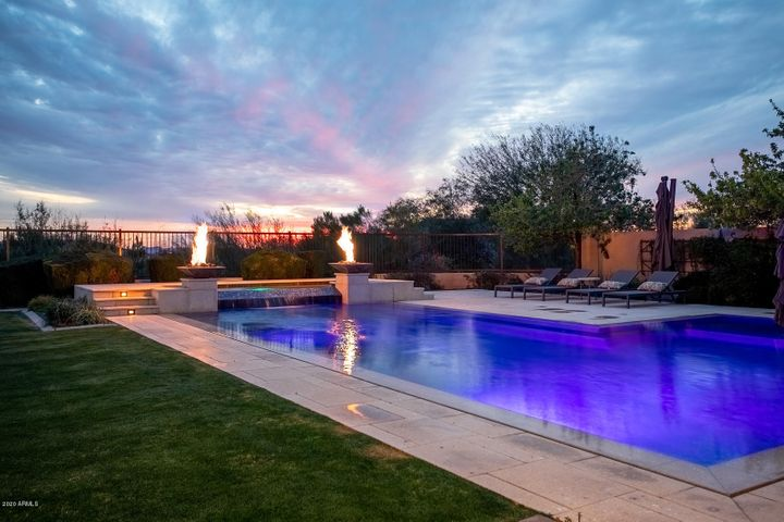 Sunset overlooking the contemporary pool