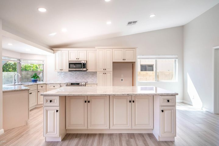 All new custom gourmet remodeled kitchen! Cabinets are antique white birch wood w/soft close drawers & doors & pull out shelves. Gorgeous slab granite counters.