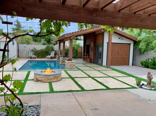Custom pergola offers additional seating in back