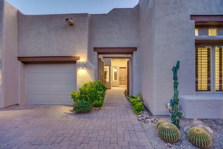 Territorial Style Home with Desert Landscaping