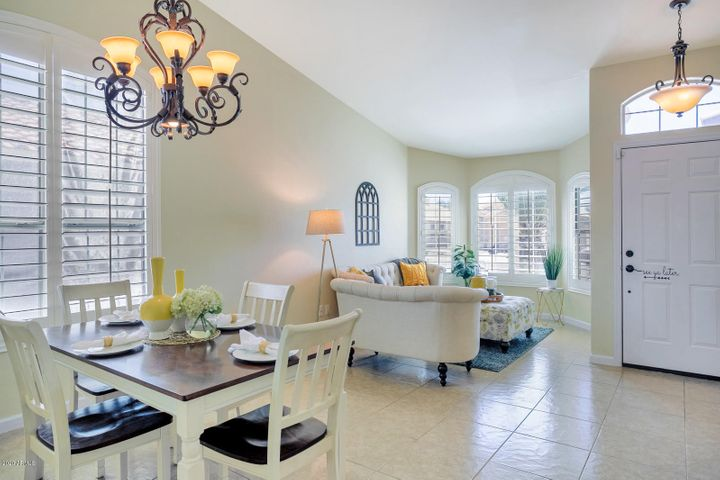 Gorgeous plantation shutters throughout main floor & upgraded light fixtures.
