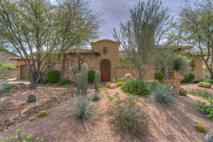 The artfully landscaped lot leads you into this stunning home.