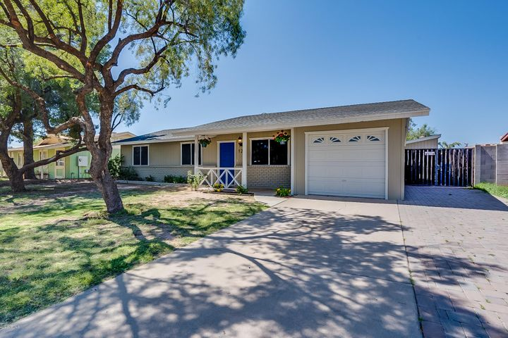 Enclosed Garage, RV Gate and extended paver parking.
