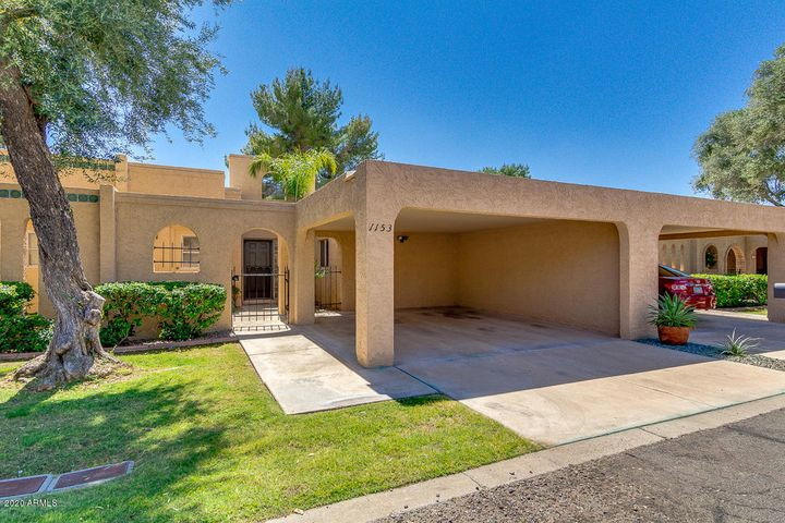 Great Curb Appeal with beautiful grassy front yard with mature tree. You will love the archway adorned with beautiful