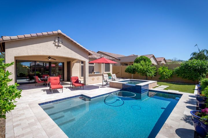Backyard with pool, spa, BBQ and desert wash behind and to the west