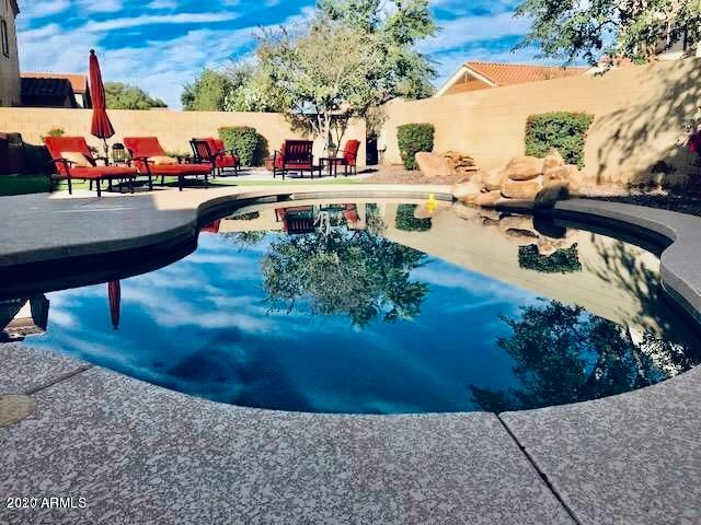 New pool built by Pesidential pools in 2015, with real rock waterfall