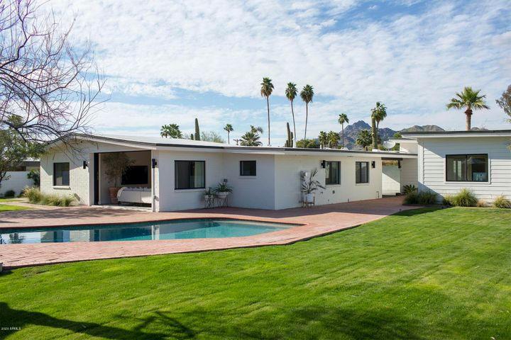 Spacious 24,320 sq. ft lot with pool and custom outdoor fireplace.