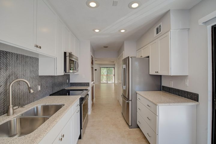 Beautiful 2nd floor condo features gorgeous remodeled kitchen