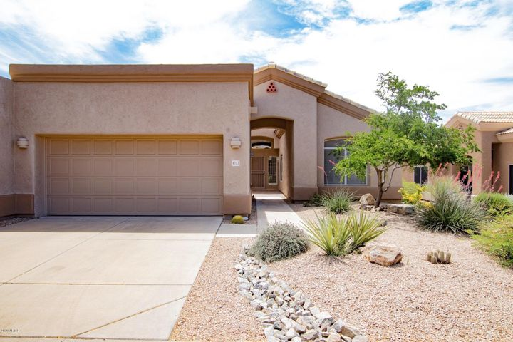 Great curb appeal, refreshed landscaping, and a private paver-courtyard