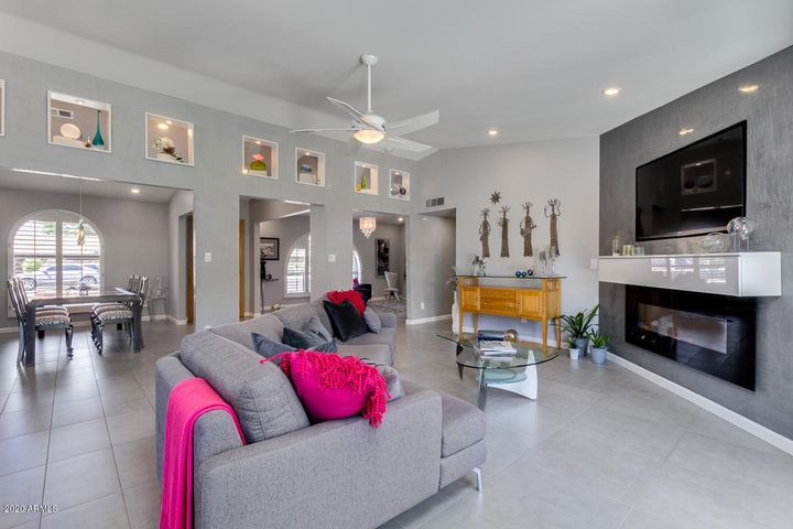 Professionally upgraded living space with walls opened up, decorative clerestory cut outs, upgraded wall textures, redesigned fireplace, new flooring, fixtures and lighting.