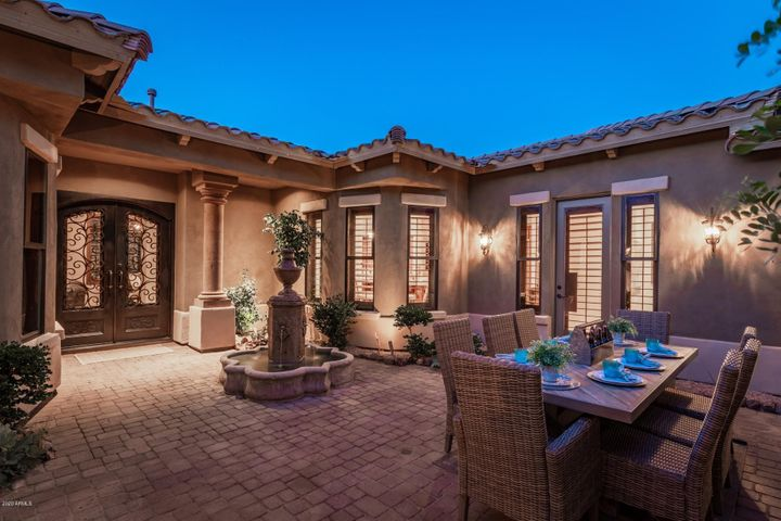 Private Courtyard with Water Feature, Pavers & Gas Stone Fireplace!