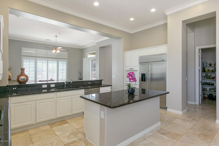 Kitchen with Island, White Cabinets and Granite Countertops