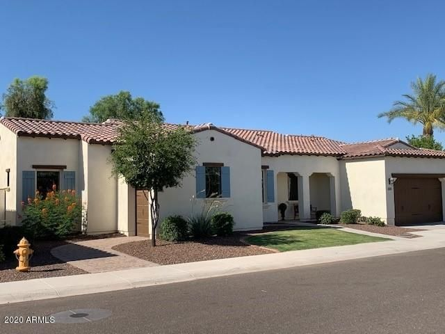Former model home with countless upgrades, plus golf cart garage.