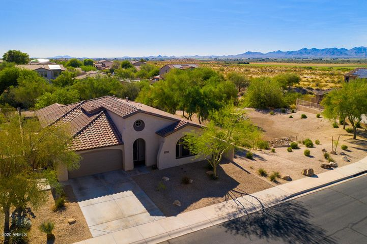 at 9318 S 181st Dr. with backdrop of the White Tank Mountains.