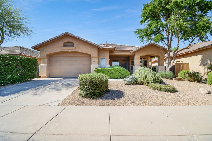 Welcome to charming Grayhawk! Situated among mature trees and manicured shrubs with the desirable north/south exposure.