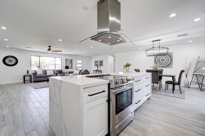 Kitchen w/ Waterfall Island / Breakfast Bar, White Shaker Cabinetry, Quartz Countertops and Tons of Natural Light