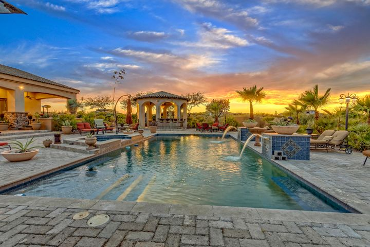 Breathtaking sunsets by a resort style pool with outdoor bar, gazebo and two fire pits. As well as a roof top deck complete with a bar and fire pit.