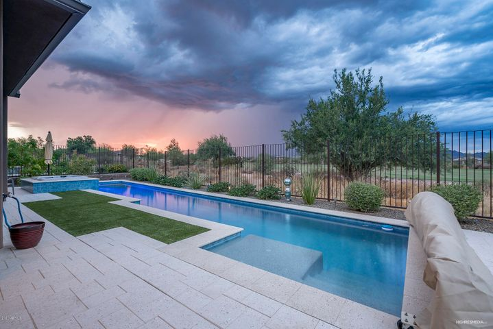 Glorious sunsets, with views of Trilogy golf course and surrounding mountains.