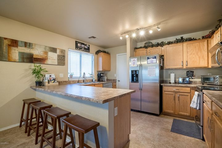 Welcome to your charming two story 5bed / 2.5baths - 2,178 sqft home. Located it in the very up & coming El Mirage.
