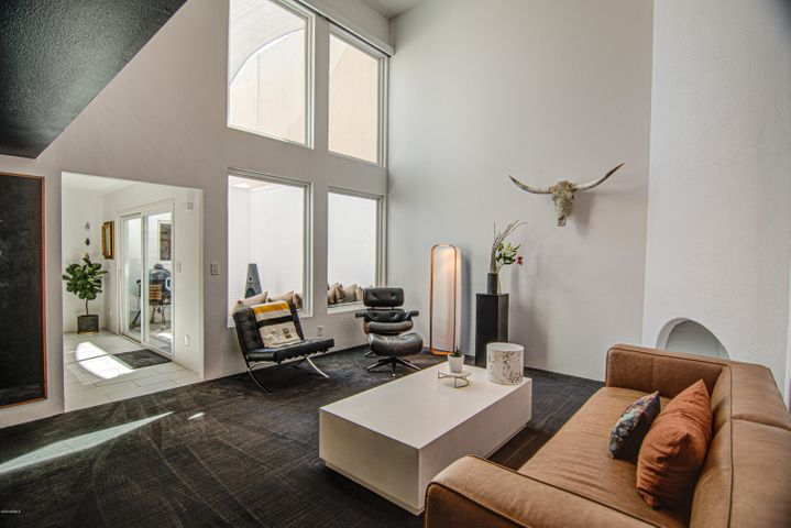 An abundance of natural light in the family room highlighted by a wall of windows.