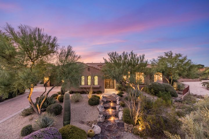 Excellent curb appeal with slate walkways, paver drive, and custom courtyard gate.