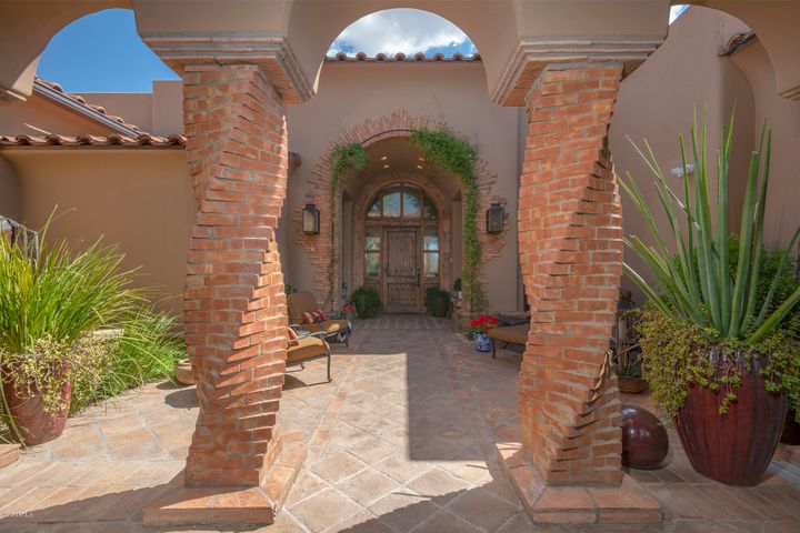 Front entrance with fountain and unique pillars - a true masterpiece.